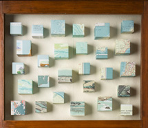 At Once our Vastness is our Limitation, 2009, hand cut paper cubes, wallpaper & found cabinet, 91.5 x 62 x 8 cm