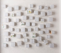Desert(ion) (white), 2009, hand cut paper cubes & wallpaper, 70 x 81 x 10 cm